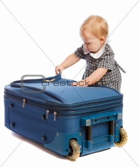 Baby opens suitcase
