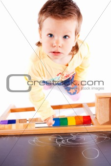 Toddler near blackboard