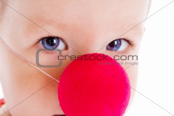 Baby with clown nose