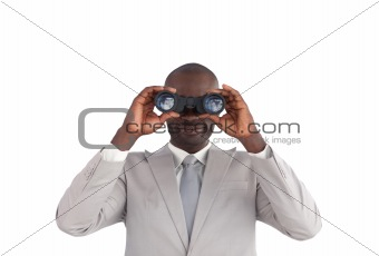 Business man looking through binoculars