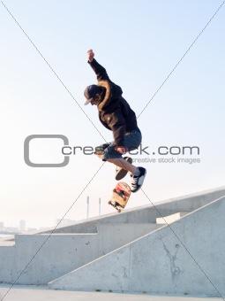Modern teenage skater catching some air