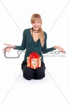 Portrait of an beautiful young woman holding a gift.