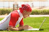 Sport man & laptop on the beach