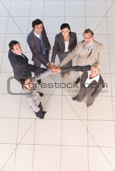 Portrait of business people  holding hands