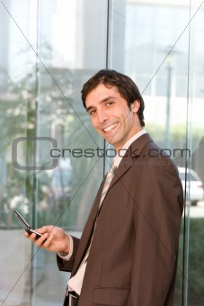 portrait of confident smiling business man holding cell phone