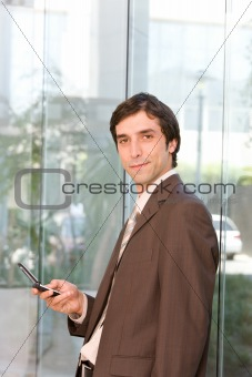 portrait of confident business man holding cell phone