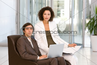 portrait of business executives working on laptop