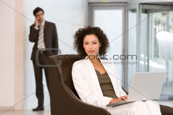 Attractive business woman working on laptop