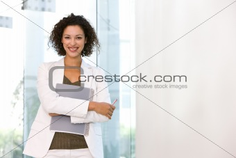 Portrait of attractive business woman holding folder