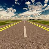 Asphalt road and clous sky