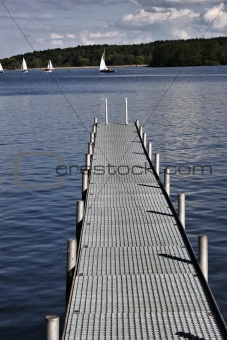 footbridge reaches into a lake