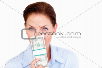 Beautiful young lady holding cash against white