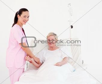 Nurse measuring a patients Pulse
