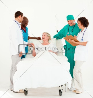 Doctors looking after a patient and bedside