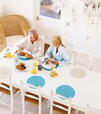 Healthy retired old couple having breakfast in the morning