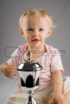 Baby girl with silver trophy