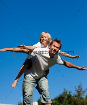 Child on his fathers back