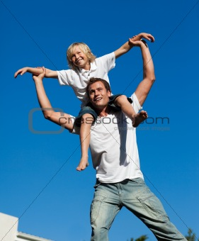 father with his son on his back