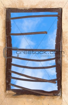 Old window closed by rusty lattice