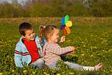 Kids playing on the spring flower field
