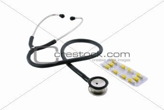 Phonendoscope and pills isolated on white background