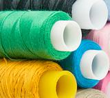 Many colorful different threads over background