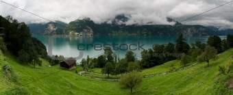 clear water of Urnersee lake in Switzerland - panoramic picture