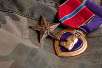 Bronze and Purple Heart Medals on Camouflage Material