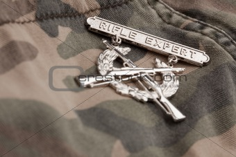 Rifle Expert War Medal on a Camouflage Material.