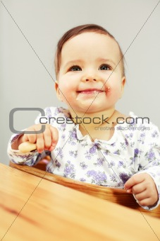 Small cute baby eating