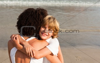 Young boy hugging his mother