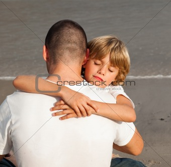 Young Boy Hugging his father
