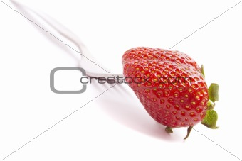 fork and fresh strawberry