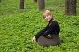 Blond beautiful girl in the spring forest.