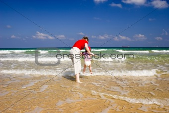 Mum with the child on the sea