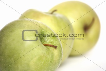 Three green apples in a number