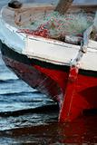 Red and White Sailing boat stranded at low tide in ocean Mozambi