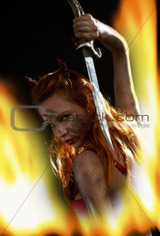 dark devil girl with a knife in fire