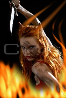 red devil girl with a knife in fire