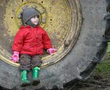 child on wheel