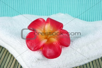 Candle on a white towel - spa products