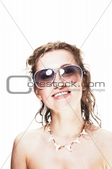 Cute young woman wearing sunglasses and shark necklace on white - surfer's girlfriend