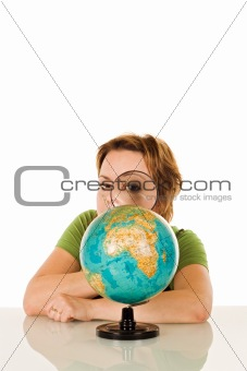 Woman looking at globe