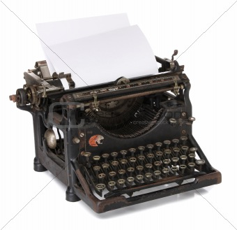 Old typewriter with a blank paper