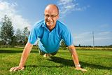 Older man doing push-ups