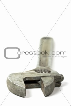 Old adjustable spanner isolated