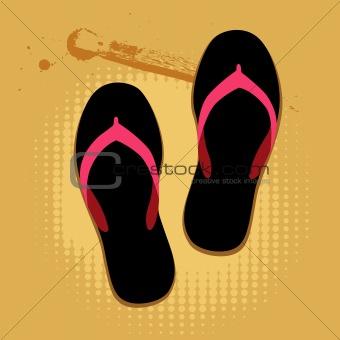 Beach sandals on sand