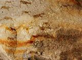 Wall cave with drawings of the primitive person