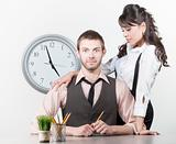 Man receiving attention from a pretty coworker
