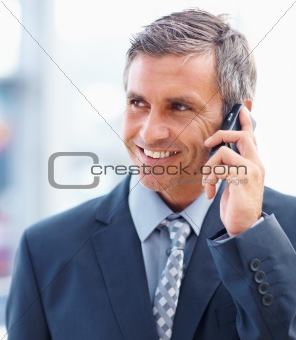 Closeup of a mature business man speaking on a cellphone